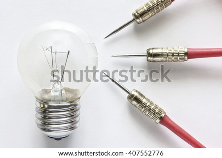 Closeup bulb lamp with three dart on white background, idea and business success concept - stock photo