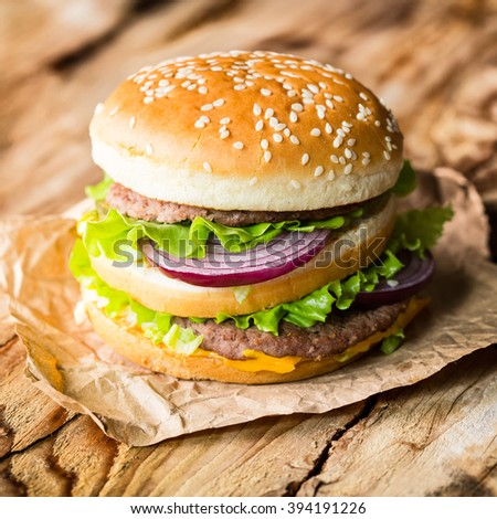 Closeup burger on wooden background