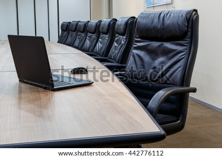 Closeup business meeting room in office before meeting. which has notebook on the table