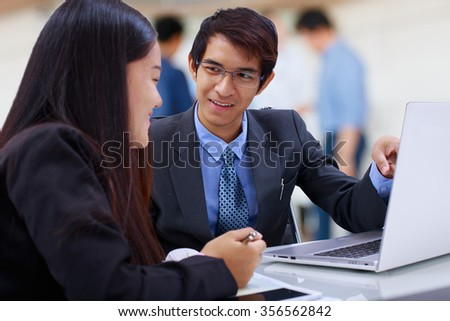 closeup business partners discussing documents and ideas at meeting - stock photo