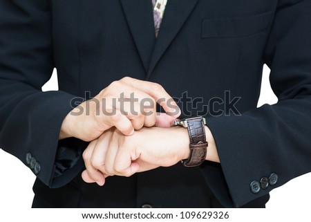 Closeup businessman checking the time on his wrist watch - stock photo