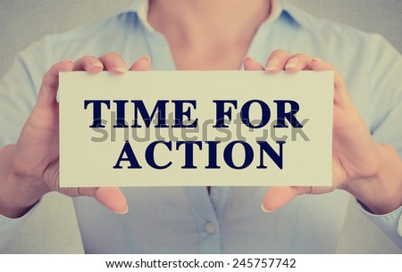 Closeup businesswoman hands holding white card sign with time for action text message isolated on grey wall office background. Retro instagram style image. Proactive life concept  - stock photo