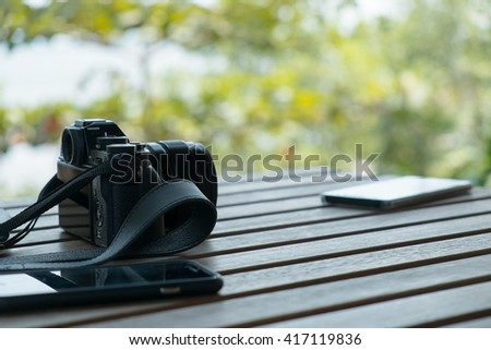 Closeup camera and mobile with side view on table