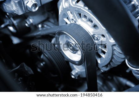 closeup car timing belt in clean engine room - stock photo