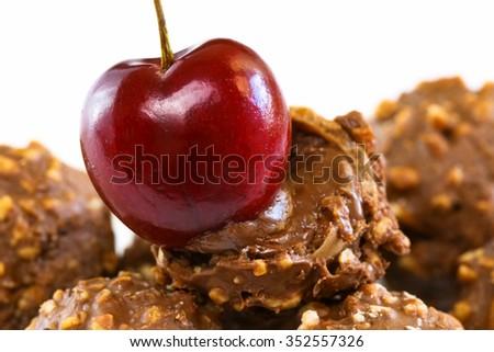 Closeup Cherry and Chocolate cream, Sweet chocolate mixed hazelnut and walnut on white background - stock photo