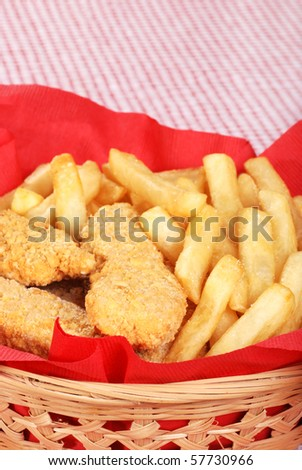 closeup chicken fingers and french fries - stock photo