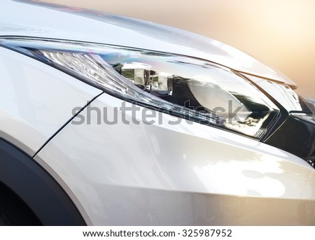 Closeup colorful headlights of car  - stock photo