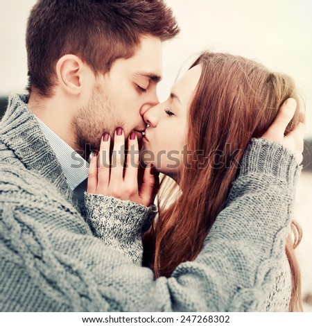 Closeup colorful stylish sensual portrait of young beautiful couple in love kissing and happy together