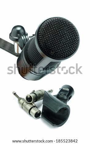 closeup condenser microphone and xlr connector - stock photo