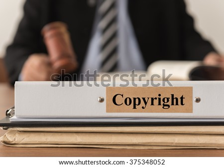closeup copyright document folder with lawyer work at law firm. concept of copyright law,  digital copyright laws,laws. - stock photo