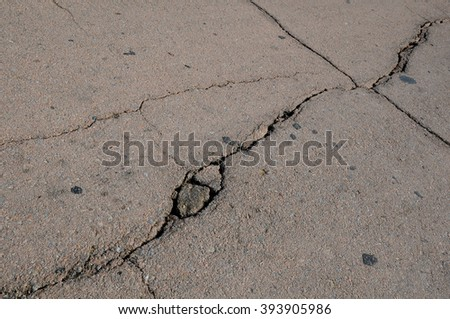 Closeup cracked asphalt pavement in Central Asia - stock photo