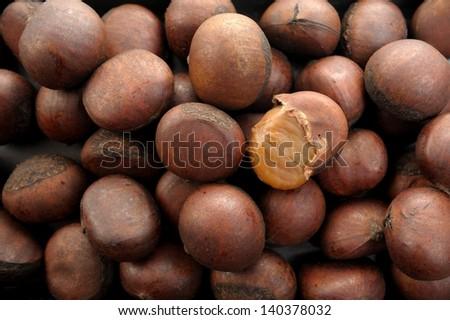closeup cracked roasted chestnut - stock photo