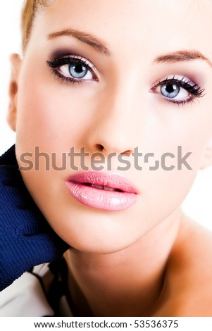 Closeup, cropped portrait of a young woman. Her hand is near her face and she is wearing gloves. Vertical shot. Isolated on white. - stock photo