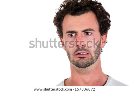 Closeup, cropped portrait of middle-aged man unhappy, worried and very troubled about something, having a desperate and crazy look in his eyes. Mental, mind health. Negative human emotions. - stock photo