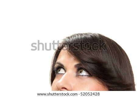 Closeup cropped view of attractive young woman looking up isolated on white - stock photo