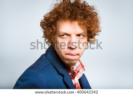 closeup curly man hostile, isolated on background - stock photo