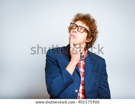 closeup curly man lost in thought, is a good idea isolated on background - stock photo