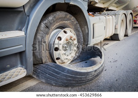 closeup damaged 18 wheeler semi truck burst tires by highway street - stock photo