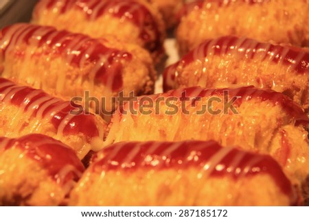 Closeup Delicious Baked Bread with Sauce on the top - stock photo