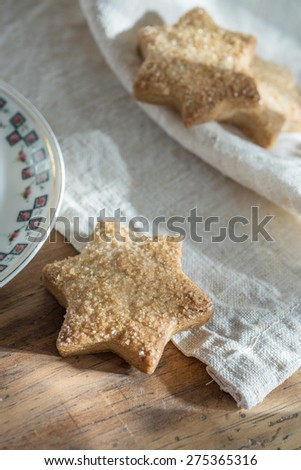 closeup, delicious shortbread placed on a napkin on a wooden table