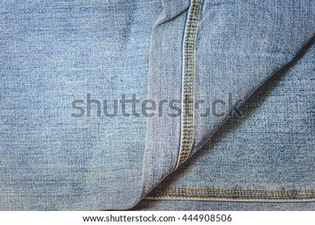 Closeup denim jeans texture. Stitched textured blue denim jeans background. Old grunge vintage denim jeans. Denim jeans with old torn of fashion jeans design with vintage tone. - stock photo