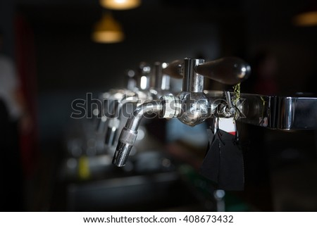 closeup detail  beer cold tap in pub