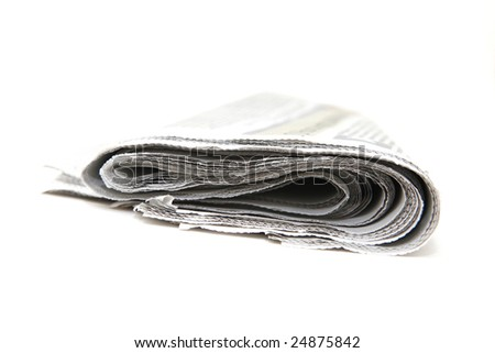 closeup detail from folded newspaper isolated on white background