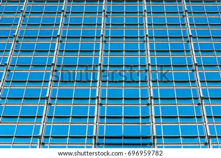 Closeup detail modern glass office building background, architecture concept