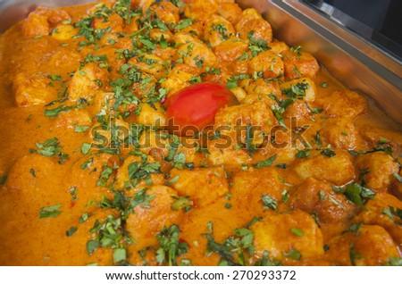 Closeup detail of a dum aloo punjabi potato curry dish on display at an indian restaurant - stock photo