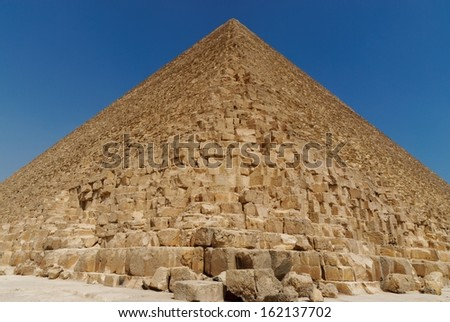 Closeup detail of a Pyramid against blue sky. Giza, Egypt. - stock photo