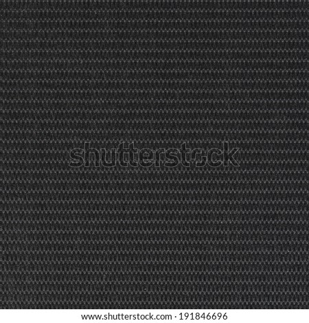 Closeup detail of background made of a black fabric texture - stock photo