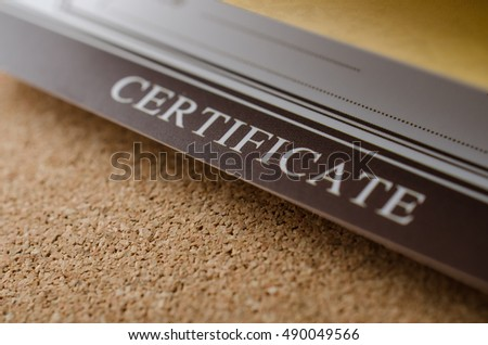 Closeup detail of certificate on brown cork background