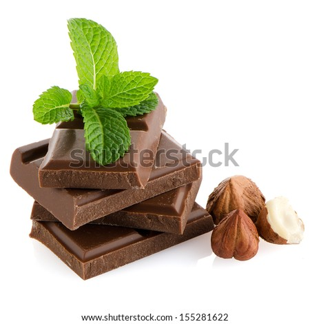 Closeup detail of chocolate parts and mint leaves on white background.