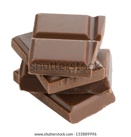 Closeup detail of chocolate parts on white background. - stock photo