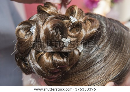 Closeup detail of female womans hair styling being styled at hairdresser salon - stock photo