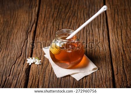 closeup detail of honey and honey dipper - stock photo