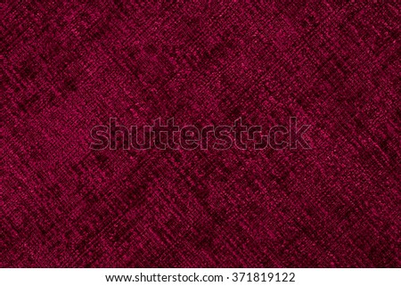 Closeup detail of red fabric texture background. - stock photo