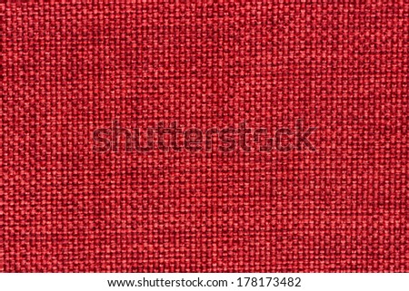 Closeup detail of red woven texture background. - stock photo