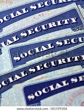 Closeup detail of several Social Security Cards representing finances and retirement - stock photo