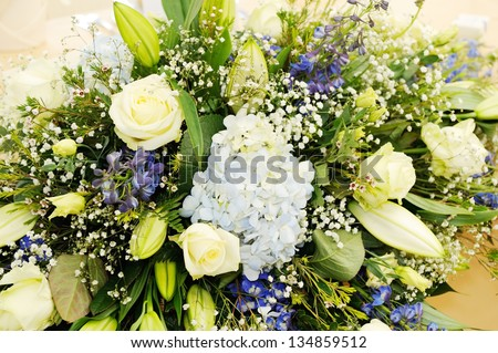 Closeup detail showing flower arrangement at wedding reception - stock photo