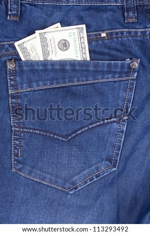 closeup dollars in a jeans pocket