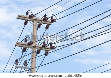 Closeup electricity pole with blue sky as background - stock photo