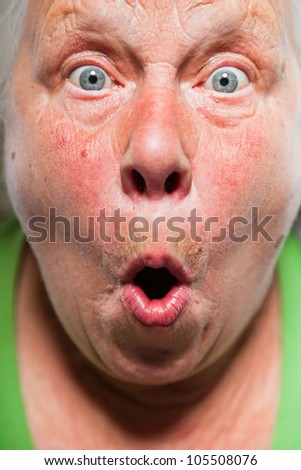 Closeup expressive face of senior woman. Studio shot. - stock photo