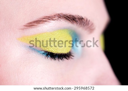 Closeup face of beautiful woman with bright fashion makeup - stock photo