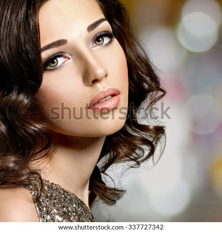 Closeup face of Beautiful  woman with brown  hairs. Pretty fashion model with dark brown eye makeup - stock photo