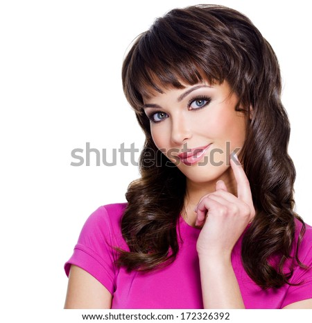 Closeup face of young thinking girl over white background
