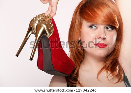 Closeup fashion girl with red high-heel shoes. Women loves shoes concept - stock photo
