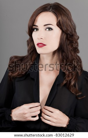 Closeup fashion portrait of beautiful woman isolated on gray background - stock photo