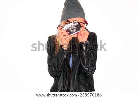 Closeup fashion portrait of pretty young smiling woman hipster style dressed in jeans shorts and black leather jacket with red lips makeup smiling and making photo on vintage film camera photographer - stock photo