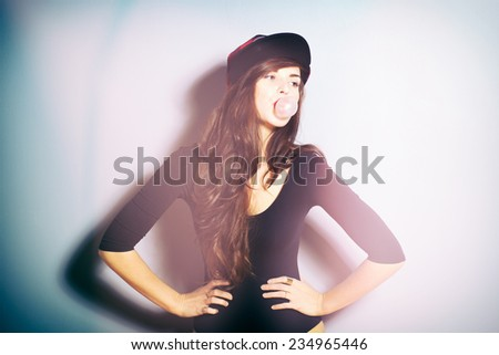 Closeup fashion studio portrait of hipster young woman, instagram effect filter - stock photo